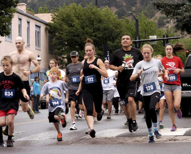 Racers head down Ninth Street toward the Rio Grande Trail at the start of the Strawberry Shortcut 5K Sunday morning in Glenwood Springs.