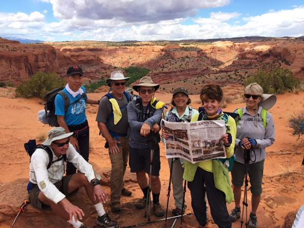 Carol Kurt and Sharon DeQuine read The Aspen Times over Cheri Grinnell's shoulder while llama trekking in Silver Springs Gulch, Escalante Grand Staircase, Utah, with Roaring Fork Valley friends. Email your