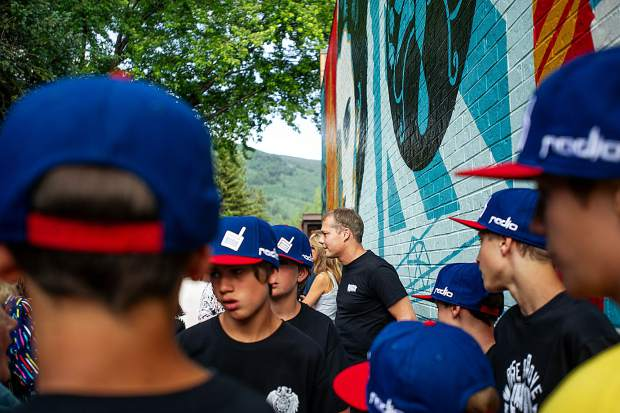 Artist Shepard Fairey speaking with guests before the unveiling of his mural,