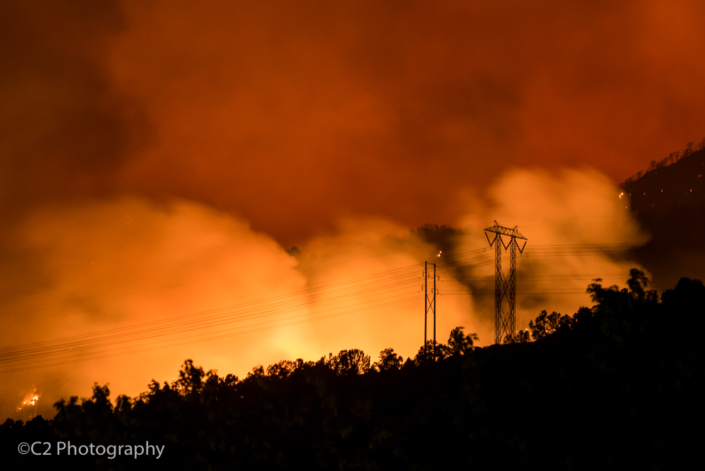 The Lake Christine fire climbs the hillside and swirls near the main transmission lines that supply power to the upper valley, as viewed from behind the Basalt Middle School late Wednesday night.