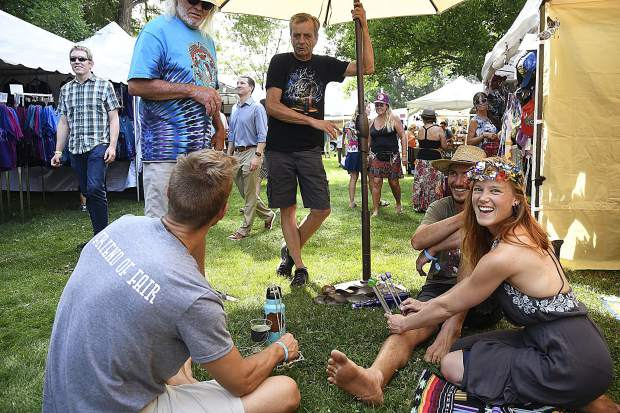 Emma Kelleher of Breckenridge demonstrates acutonics on a group of visitors to the Carbondale Mountain Fair Friday.
