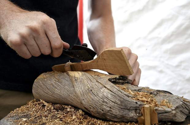 Austin Anderson of Fremont, Utah carves a wooden spatula Friday at the Mountain Fair.