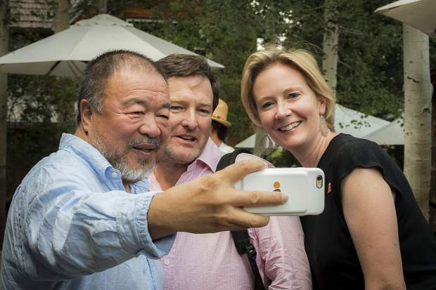Activist Ai Weiwei stopped to take a selfie Wednesday with Bill Rafferty, center, and Sara Fitzmaurice of Louisiana who came to hear him speak at Anderson Ranch in Snowmass Village. Ai stopped to take pictures with a number of people after talk.