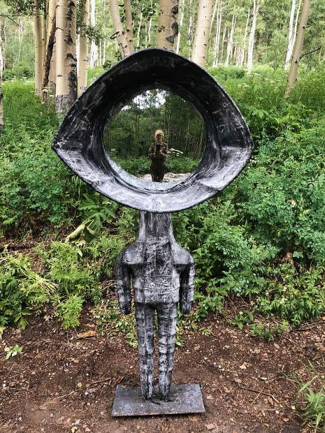 A self-portrait by Ajax Axe in one of her mirrored sculptures.