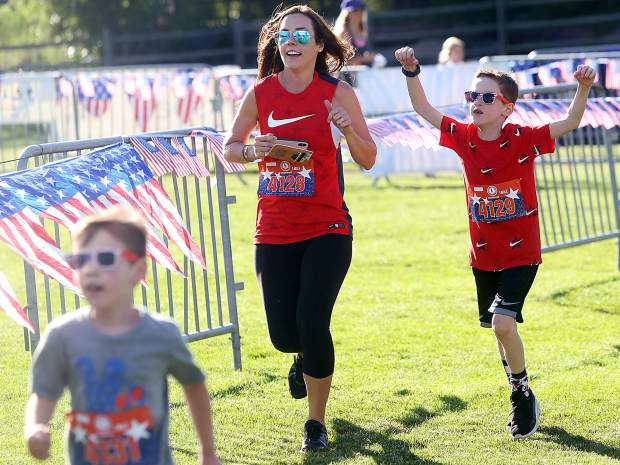 Racers cross the finish line during the 1-mile fun run of Wednesday's 32nd annual Boogie's Buddy Race at Rio Grande Park in Aspen.