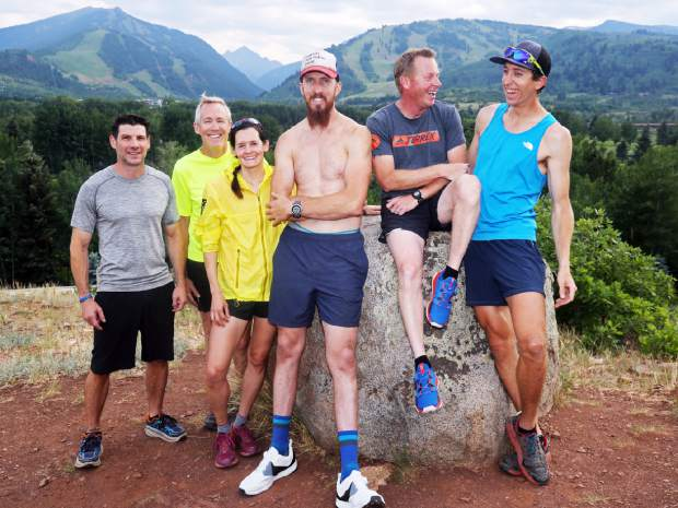 Trey Barnes and the Aspen Trailheads run up Red Butte in Aspen on Thursday, July 5, 2018.