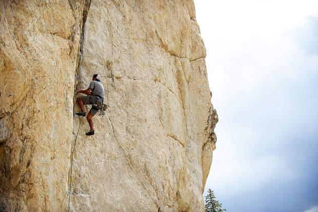A rock climber on the Grottos wall on Independence Pass on Saturday.