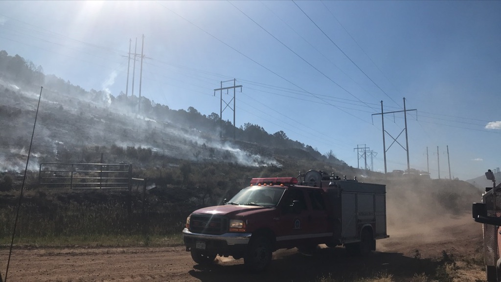 Fire crews work the Lake Christine Fire on Wednesday morning near Basalt. Officials are concerned about the wooden power poles in the burn area and if they fall it could cut power in the Roaring Fork Valley.
