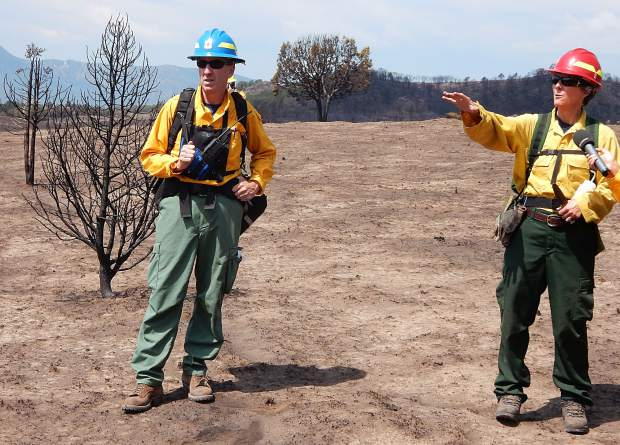 Steve Hunter, a civil engineer and hydrologist, and hydrologist Liz Schnackerberg, both with the U.S. Forest Service, are part of the Burned Area Emergency Response team that continued its assessment of the Lake Christine Fire terrain on Saturday.
