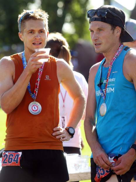 Race winner Sean Van Horn, right, and runner-up Michael Barlow chat Wednesday during the 32nd annual Boogie's Buddy Race at Rio Grande Park in Aspen.