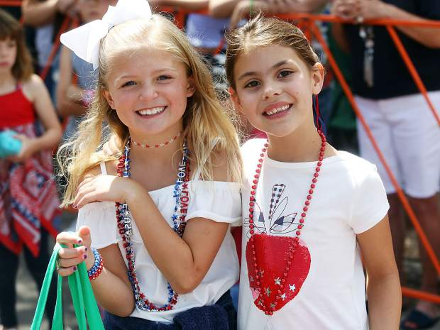 Two young girls pose for a photo during the Aspen Fourth of July parade from July 4, 2018.