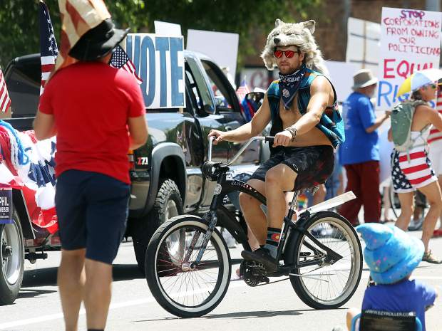 Olympic ski racer Wiley Maple rides around during the Aspen Fourth of July parade from July 4, 2018.