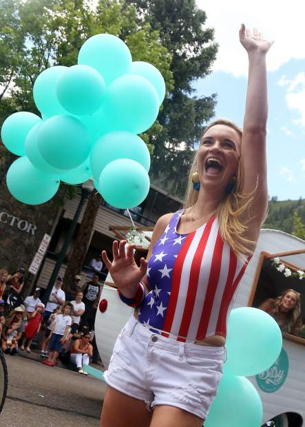 Aspen's Shannon Asher celebrates during the Fourth of July parade from July 4, 2018.