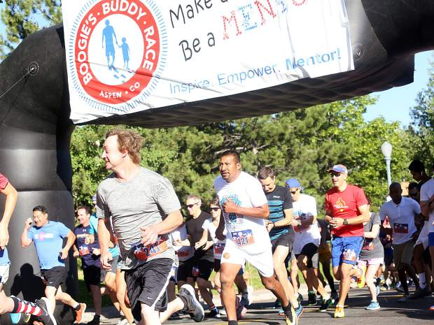 Racers take off from the start of the 32nd annual Boogie's Buddy Race on Wednesday, July 4, 2018, at Rio Grande Park in Aspen.