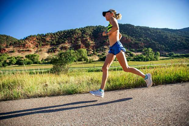 Hannah Billings of St. Louis competes in the Aspen Valley Marathon on the Rio Grande Trail on Saturday morning. Billings was the first woman to finish the full marathon with a chip time of 3:11:59.