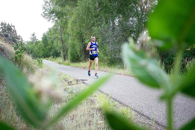 Hunter Cote of New Hampshire runs in the Aspen Valley Marathon on the Rio Grande Trail to Basalt on Saturday morning.