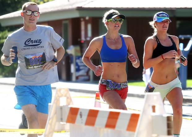 A group of runners cross the finish line for the Aspen Valley Marathon on Saturday, July 14, 2018, in Basalt.t. (Photo by Austin Colbert/The Aspen Times).