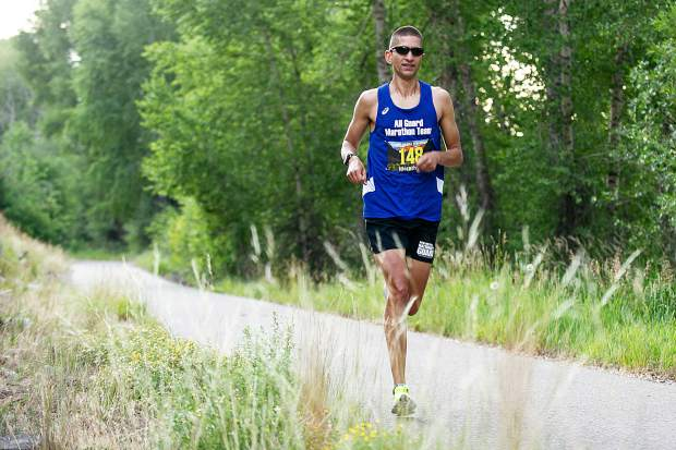 Miguel Perez, from Los Alamos, New Mexico, runs in the Aspen Valley Marathon on the Rio Grande Trail on Saturday morning. Perez took first place with a chip time of 2:40:35.
