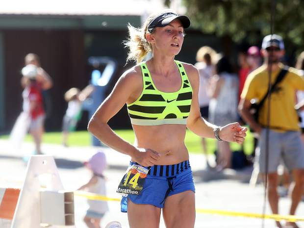 Women's marathon winner Hannah Billings crosses the finish line for the Aspen Valley Marathon on Saturday, July 14, 2018, in Basalt. (Photo by Austin Colbert/The Aspen Times).