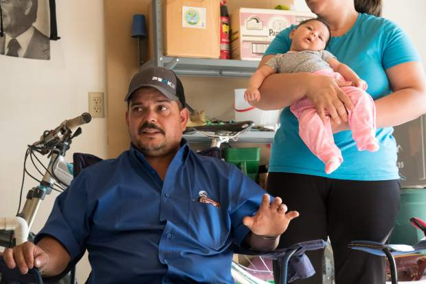 Jose Martinez speaks about how he and his family have nothing after the Lake Christine Fire destroyed their home last week. His wife Griselda and two-month-old daughter Camila are behind him.