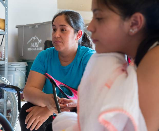 Griselda Sanchez listens as her husband describes the chaotic scene when they fled El Jebel Wednesday night.
