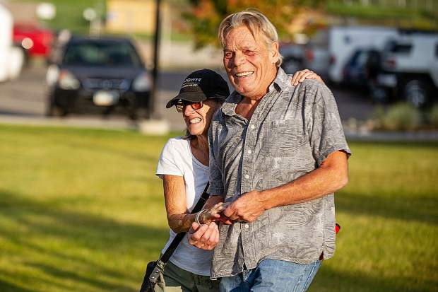 El Jebel residents Bill McCauley and his wife Andee embrace and are still able to smile after losing their house to the Lake Christine fire on Lava Drive just outside of the El Jebel mobile home park after the community briefing at the Basalt High School on Thursday evening.