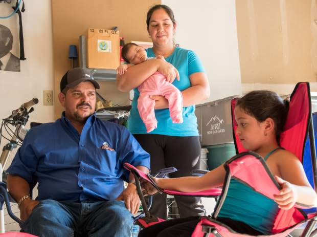 Jose Martinez looks to his six-year-old daughter Andreina and mentions that although he has nothing left after the Lake Christine Fire destroyed his home he feels that he still came away with the most important thing in his life-his daughters. His wife Griselda and two-month-old daughter Camila are behind him.