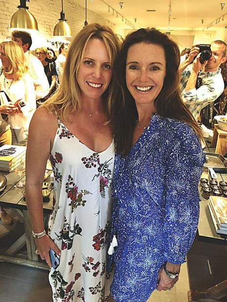Kimberly Seguin and Vanessa Adam at a summer soiree.