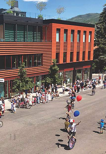 Unicyclist extraordinaire Mike Tierney leads a team of talented balancing acts in the Fourth of July Parade through Aspen.