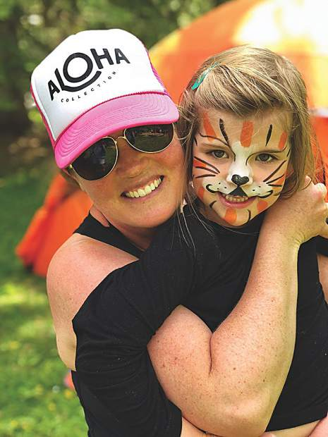 Mandy Welgos with her adorable daughter, Abby, at a summer birthday party.