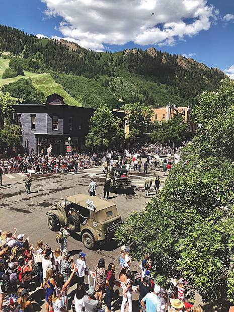 U.S. veterans receive a stream of applause and standing ovations throughout the streets of Aspen during the Fourth of July parade.