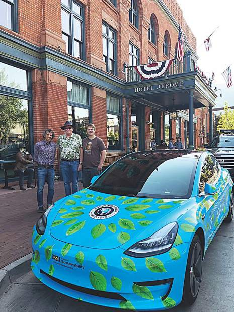 Aspen Mayor Steve Skadron visits with John Martinson and his son, Neo, and their fully electric 2018 Tesla Model 3 on the 4th of July. The pair is traveling over 6,000 miles in this car through ten Western states and two Canadian provinces, raising awareness for Arizona State University's School of Sustainability and funds for Rocky Mountain Institute. Courtesy photo.