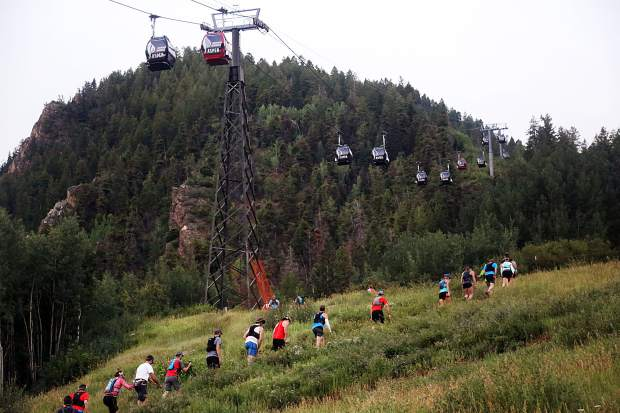 Runners begin to climb Aspen Mountain during the Power of Four trail run on Sunday, July 29, 2018. (Photo by Austin Colbert/The Aspen Times).