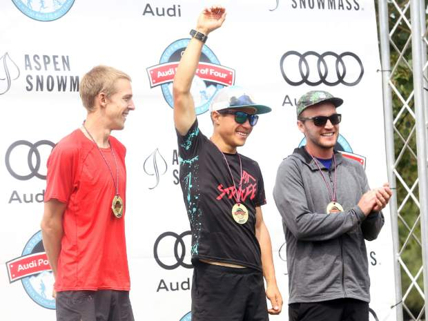 Aspen's Max Taam, center, celebrates on the podium after winning the Power of Four Triple Crown on Sunday, July 29, 2018. Steve Denny, left, was second while Jon Jay was third. (Photo by Austin Colbert/The Aspen Times).
