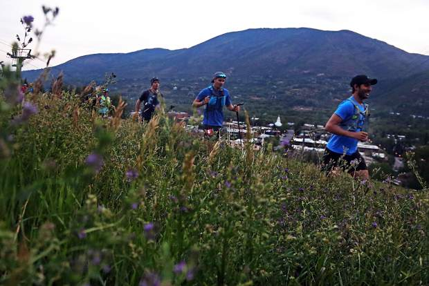 Competitors begin to ascend Aspen Mountain during the Power of Four 50k trail run on Sunday, July 29, 2018. (Photo by Austin Colbert/The Aspen Times).