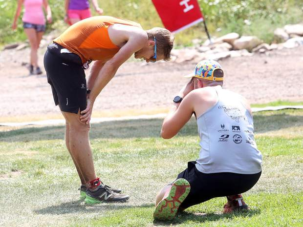Aspen's Michael Barlow catches his breath after winning the Power of Four 50k trail run on Sunday, July 29, 2018. (Photo by Austin Colbert/The Aspen Times).