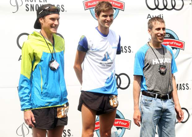 From left, Sean Van Horn, winner Lindon Powell and Timmy Parr stand on the men's Power of Two 25k trail run podium on Sunday, July 29, 2018. (Photo by Austin Colbert/The Aspen Times).