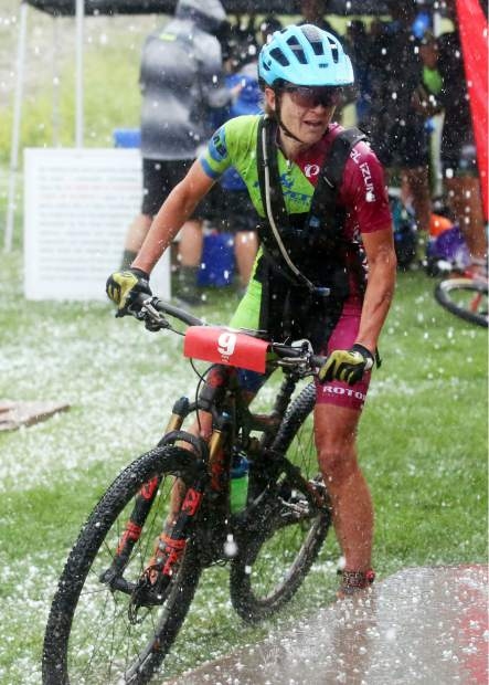 Women's race winner Marlee Dixon crossed the finish line during a hail storm at the Power of Four mountain bike race on Saturday, July 28, 2018. (Photo by Austin Colbert/The Aspen Times).