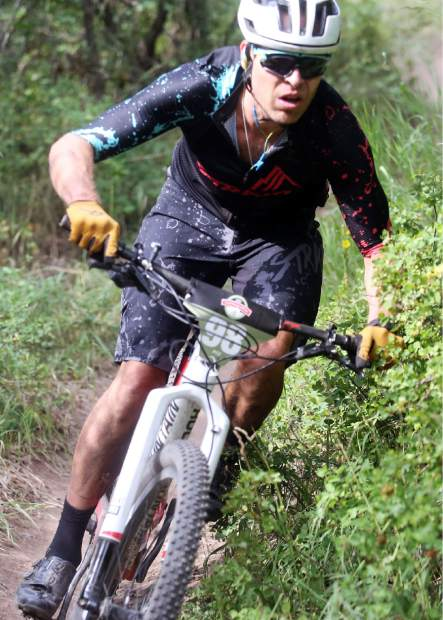 Race winner Gregory Strokes competes in the Power of Two mountain bike race on Saturday, July 28, 2018. (Photo by Austin Colbert/The Aspen Times).