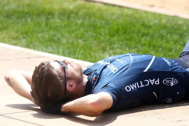 Race winner Thomas Herman relaxes after finishing the Power of Four mountain bike race on Saturday, July 28, 2018. (Photo by Austin Colbert/The Aspen Times).
