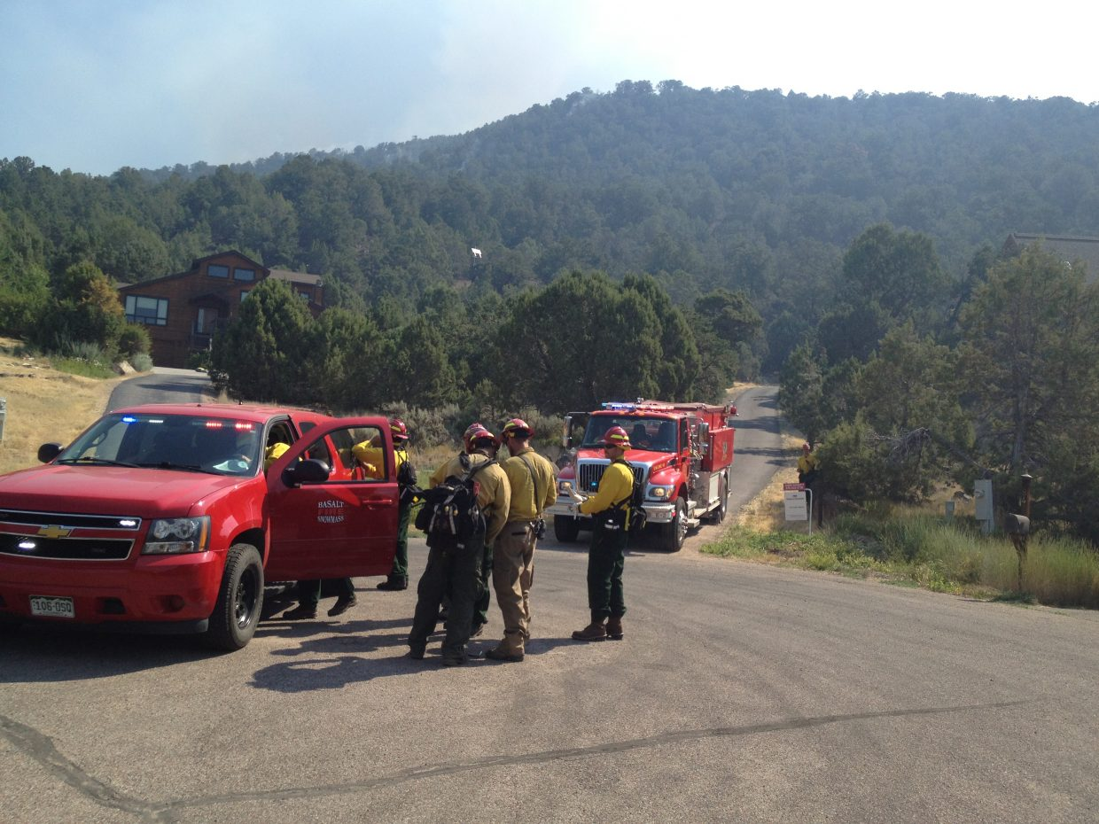 Fire crews gather near Aspen Junction as they work the Lake Christine Fire on Wednesday morning.