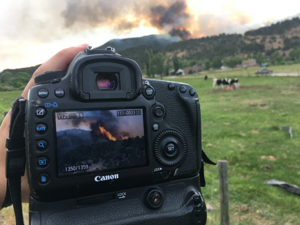 A wildfire started at the shooting range northwest of downtown Basalt and is moving uphill.