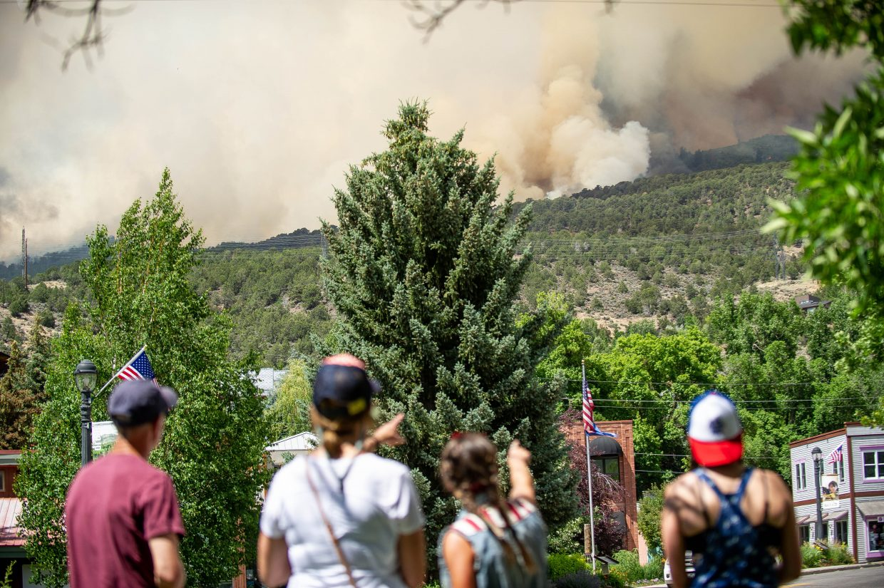 People watch as the Lake Christine Fire burns Wednesday afternoon near Basalt.