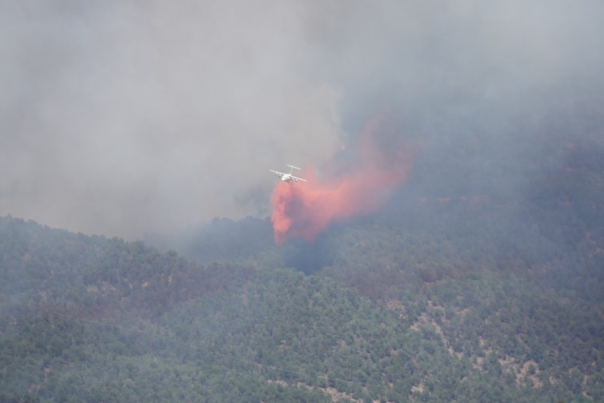 A plane drops slurry on at the Lake Christine Fire on Wednesday afternoon about 2:30 p.m. from the Deadwood Ranch.
