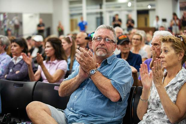 Lazy Glen residents Cindy Maetzold and KC Johnson clap at the community meeting regarding the Lake Christine fire on Thursday night when Eagle County Sheriff James Van Beek announced the evacuation facilities safe zones for everyone emphasizing including the immigrant population.