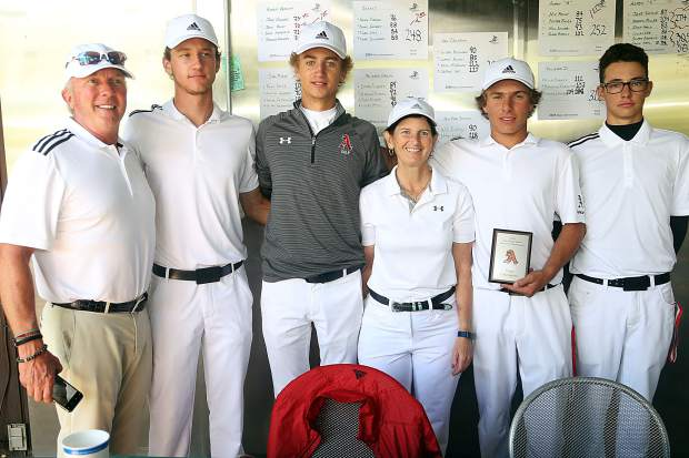 The Aspen High School boys golf team takes a photo after winning its home tournament on Friday, Aug. 17, 2018 at Aspen Golf Club. From left are assistant coach Don Buchholz, senior Dawson Holmes, senior Dominic Lanese, head coach Mary Woulfe, junior Jack Pevny and senior Jack Hughes. (Photo by Austin Colbert/The Aspen Times).