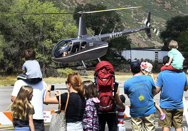 Visitors to the Aviation Expo get an upclose look as a helicopter takes off from Glenwood Springs Airport Saturday.