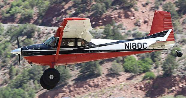 A 1956 Cessna 180 makes its landing approach with passengers during Saturday's Aviation Expo.