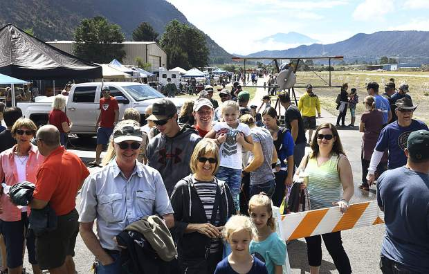 Visitors to the Aviation Expo at the Glenwood Springs Airport are all smiles as they wait for their turn to ride in one of the planes on hand Saturday.