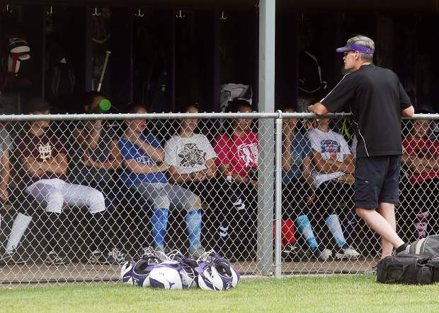 First-year coach David Miller talks to the Basalt High School softball players prior to practice on Aug. 16 on the BHS field.